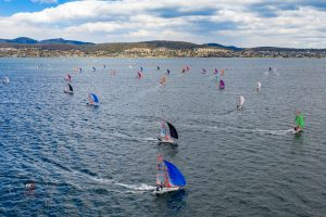 29er fleet tearing across the Derwent River in Hobart during the National Championships. Photo by Hartas Productions