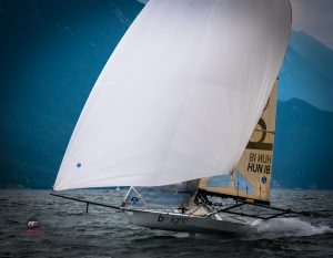 Hungarian 18ft skiff team Be Light! flying downwind past the Hartas Productions sailing photographer